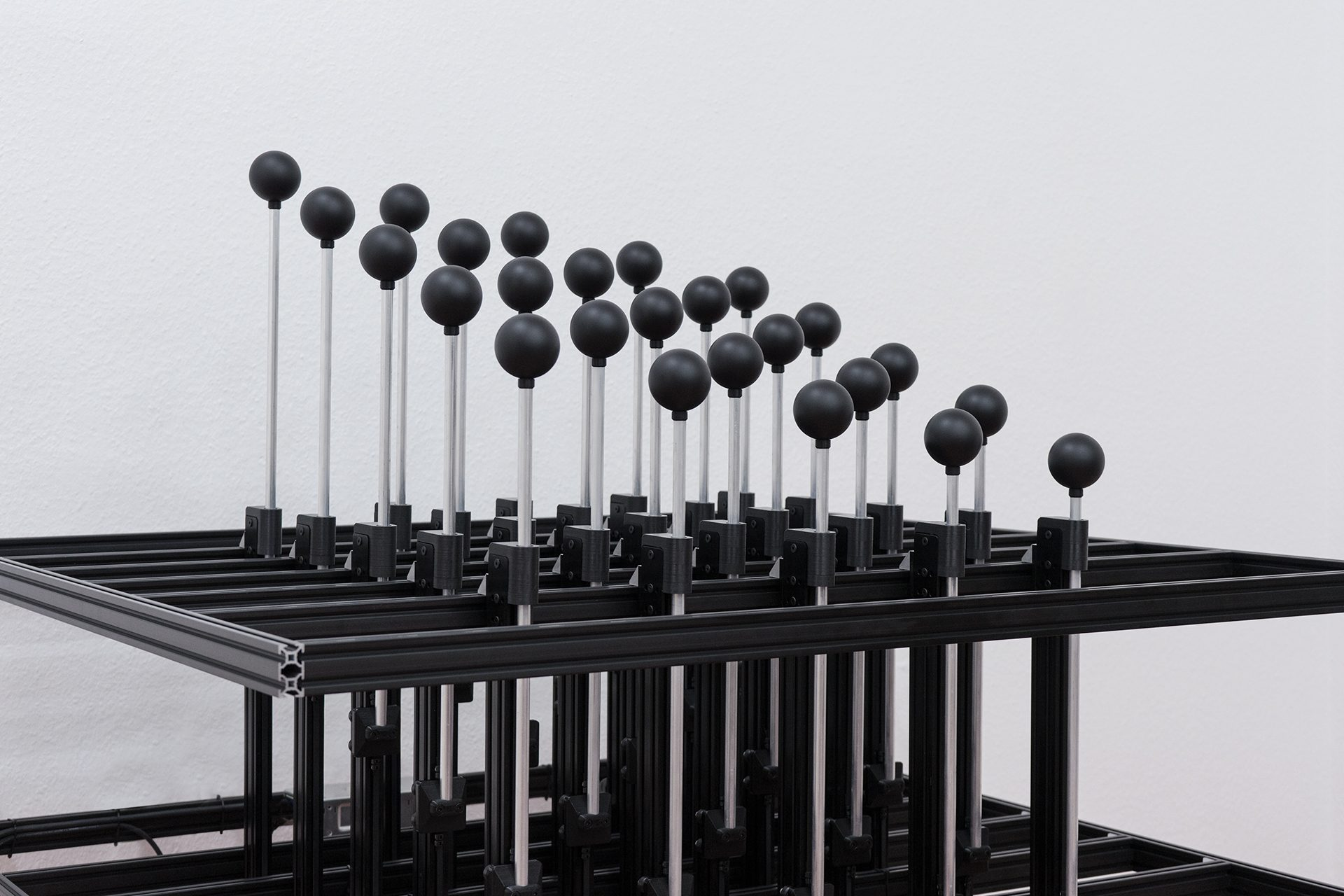 DMX Linear Actuator Slim with a black sphere fixture